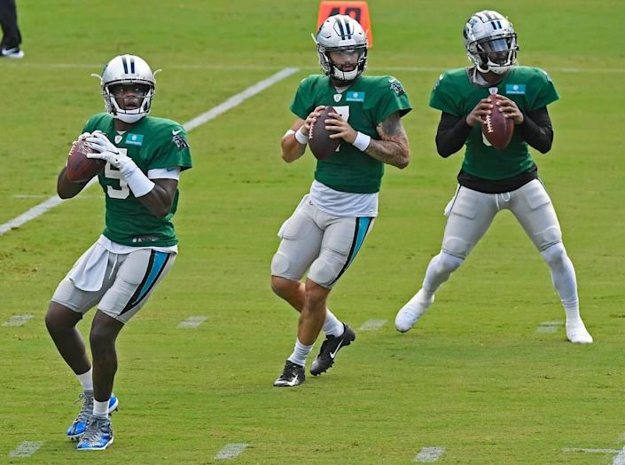 Carolina Panthers quarterback Teddy Bridgewater (5), quarterback Will Grier (7), and quarterback P.J. Walker (6) drop back to pass during practice at Bank of America Stadium during training camp on Saturday, August 22, 2020.