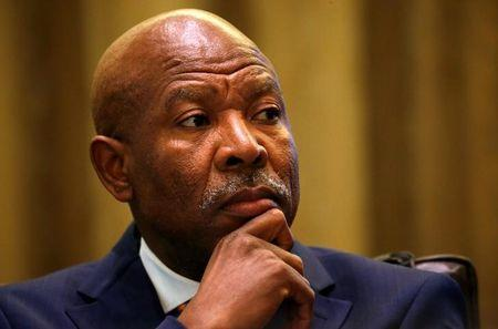 South African Reserve Bank governor Lesetja Kganyago listens during a briefing at Parliament in Cape Town