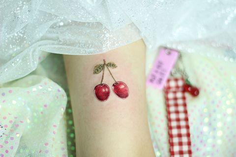 "<p>The bright-red ink in this dreamy cherry tattoo is so vibrant, but the design is simple enough that you'll never get sick of it.</p><p><a href=""https://www.instagram.com/p/Bmf-DO-lngt/"" rel=""nofollow noopener"" target=""_blank"" data-ylk=""slk:See the original post on Instagram"" class=""link rapid-noclick-resp"">See the original post on Instagram</a></p>"