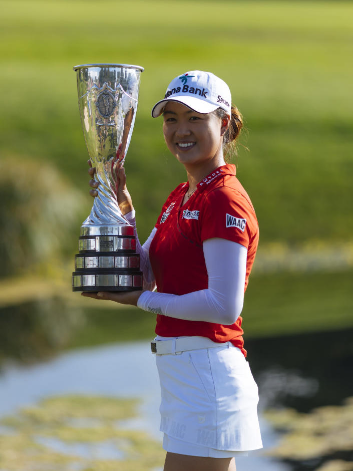 Australia's Minjee Lee holds the trophy as she poses for photographers after winning the Evian Championship women's golf tournament in Evian, eastern France, Sunday, July 25, 2021. (AP Photo)