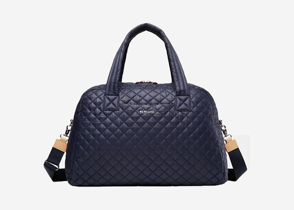 """<p>MZ Wallace's tote bag has <a href=""""https://www.cntraveler.com/story/mz-wallace-metro-tote-editor-recommends?mbid=synd_yahoo_rss"""" rel=""""nofollow noopener"""" target=""""_blank"""" data-ylk=""""slk:earned high praise"""" class=""""link rapid-noclick-resp"""">earned high praise</a> from editor Meredith Carey thanks to its versatility and roominess, so it's no surprise the brand has one of the best weekender bags, too. It's incredibly lightweight (just over a pound), with natural Italian leather trim that elevates the puffy, quilted fabric look. Inside, you'll find six interior pockets, a detachable pouch, phone pocket, and key ring strap—an organized traveler's dream.</p> <p> <strong>Buy now:</strong> <a href=""""https://fave.co/2AQMdYI"""" rel=""""nofollow noopener"""" target=""""_blank"""" data-ylk=""""slk:$295, mzwallace.com"""" class=""""link rapid-noclick-resp"""">$295, mzwallace.com</a></p>"""