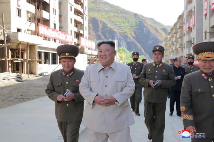 North Korean leader Kim Jong Un inspects a damage recovery site affected by heavy rains and winds caused by recent typhoons, in Geomdeok district, South Hamgyong