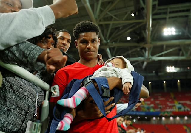 <p>England's Marcus Rashford with a child after the match. REUTERS/John Sibley </p>