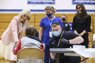 First lady Jill Biden and actress Jennifer Garner, right, speak to people being vaccinated for COVID-19 at Capitol High School in Charleston, W.Va., Thursday, May 13, 2021. (Oliver Contreras/The New York Times via AP, Pool)