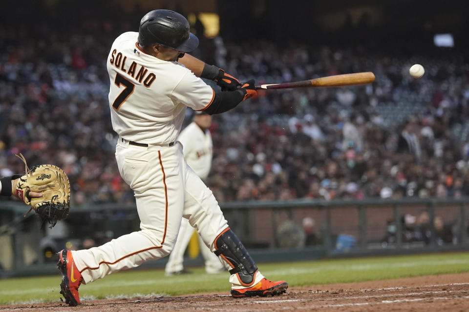 San Francisco Giants' Donovan Solano breaks his bat hitting an RBI-double against the St. Louis Cardinals during the fifth inning of a baseball game in San Francisco, Wednesday, July 7, 2021. (AP Photo/Jeff Chiu)