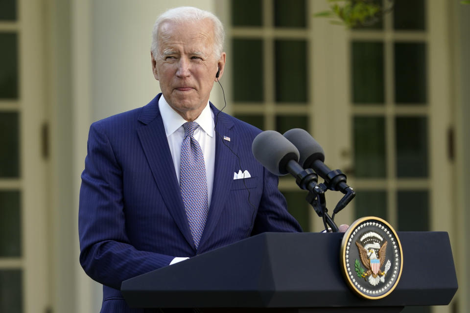 President Joe Biden listens as Japanese Prime Minister Yoshihide Suga speaks at a news conference in the Rose Garden of the White House, Friday, April 16, 2021, in Washington. (AP Photo/Andrew Harnik)