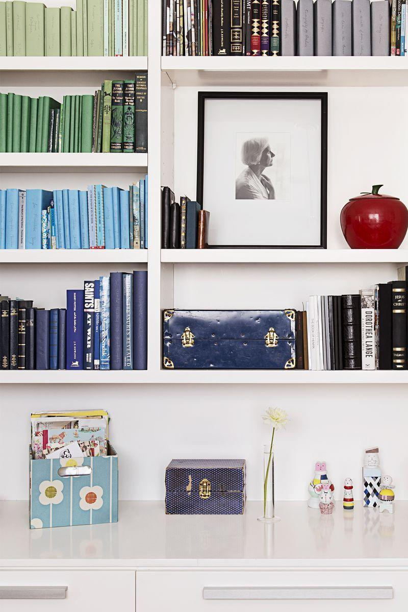 <p>While there are a variety of visually appealing ways to organize bookshelves, a color-coordinated look never fails to make you want to read to your heart's content. </p>
