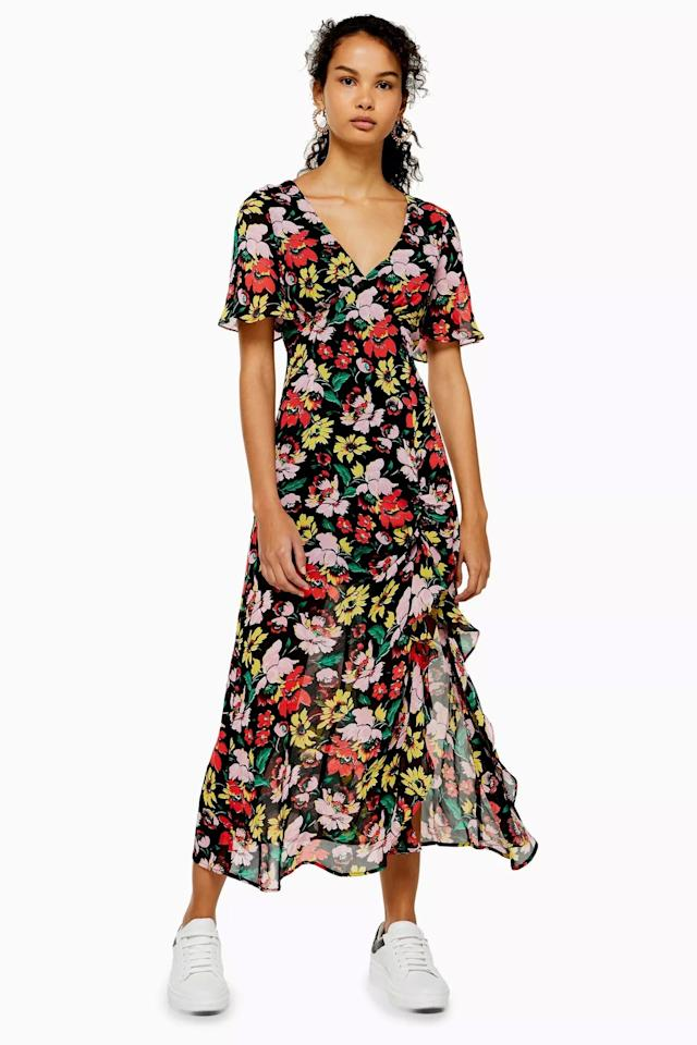 "<p>We love how this <a href=""https://www.popsugar.com/buy/Floral%20V-Neck%20Angel%20Sleeve%20Dress-472001?p_name=Floral%20V-Neck%20Angel%20Sleeve%20Dress&retailer=us.topshop.com&price=95&evar1=fab%3Aus&evar9=46417883&evar98=https%3A%2F%2Fwww.popsugar.com%2Ffashion%2Fphoto-gallery%2F46417883%2Fimage%2F46417892%2FFloral-V-Neck-Angel-Sleeve-Dress&list1=shopping%2Cdresses%2Ctopshop%2Csummer%20fashion&prop13=api&pdata=1"" rel=""nofollow"" data-shoppable-link=""1"" target=""_blank"" class=""ga-track"" data-ga-category=""Related"" data-ga-label=""https://us.topshop.com/en/tsus/product/clothing-70483/dresses-70497/floral-v-neck-angel-sleeve-dress-8946853"" data-ga-action=""In-Line Links"">Floral V-Neck Angel Sleeve Dress </a> ($95) looks with sneakers.</p>"
