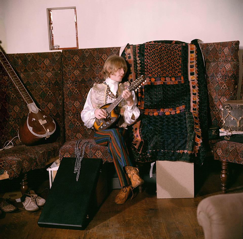 Brian Jones at home on a settee. Courtfield Gardens, South KensingtonGered Mankowitz