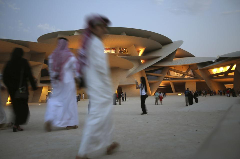 FILE - In this April 20, 2019, file photo, people visit the National Museum of Qatar in Doha, Qatar. Qataris awoke to a surprise blockade and boycott by Gulf Arab neighbors 3 1/2 years ago, and this week were jolted again by the sudden announcement that it was all over. (AP Photo/Kamran Jebreili, File)