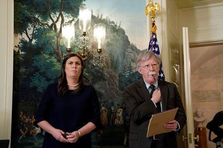 New National Security Adviser John Bolton and White House Press Secretary Sarah Huckabee Sanders listen to U.S. President Donald Trump's statement on Syria at the White House in Washington, U.S., April 13, 2018. REUTERS/Yuri Gripas