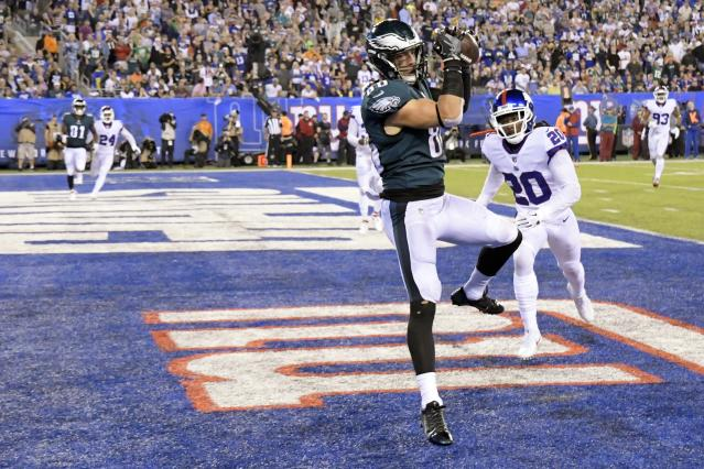 Philadelphia Eagles' Zach Ertz (86) catches a pass for a touchdown in front of New York Giants' Janoris Jenkins (20) during the first half of an NFL football game Thursday, Oct. 11, 2018, in East Rutherford, N.J. (AP Photo/Bill Kostroun)
