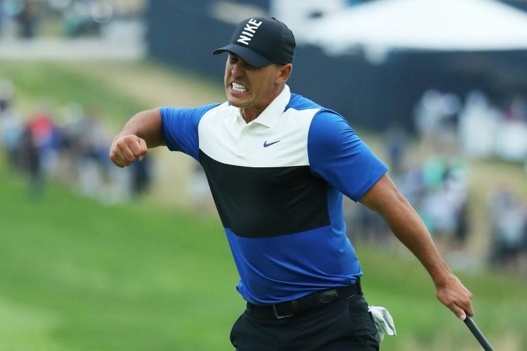 Brooks Koepka reacts after his putt on the 18th green to complete a two-stroke victory over Dustin Johnson in the 2019 PGA Championship at Bethpage Black