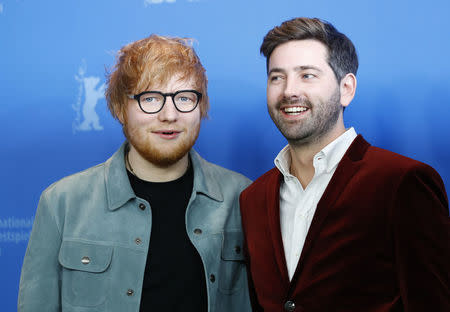 Director, screenwriter, editor and producer Murray Cummings and Ed Sheeran pose during a photocall to promote the movie Songwriter at the 68th Berlinale International Film Festival in Berlin, Germany, February 23, 2018. REUTERS/Fabrizio Bensch