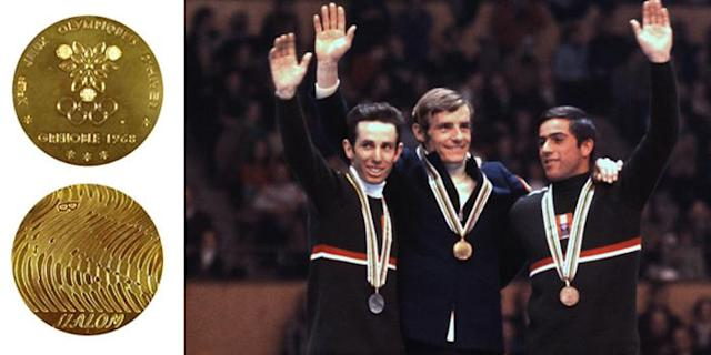 <p>The medals for the 1968 X Olympic Winter Games were the first-ever Olympic medals made for each sport discipline.<br>(IOC photo; French gold medalist Jean-Claude Killy, with Austrians Herbert Huber and Alfred Matt in Grenoble, France./Photo by IOC Olympic Museum/Allsport) </p>