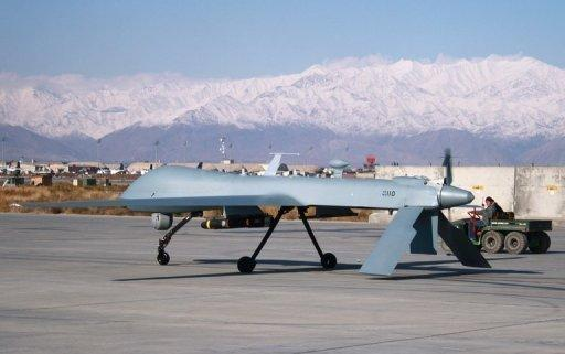 A US Predator drone sets off from its hangar at Bagram air base in Afghanistan
