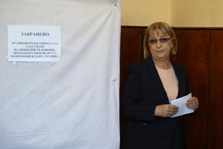 Presidential candidate for GERB party Tsacheva holds her ballot paper during a presidential election in Pleven