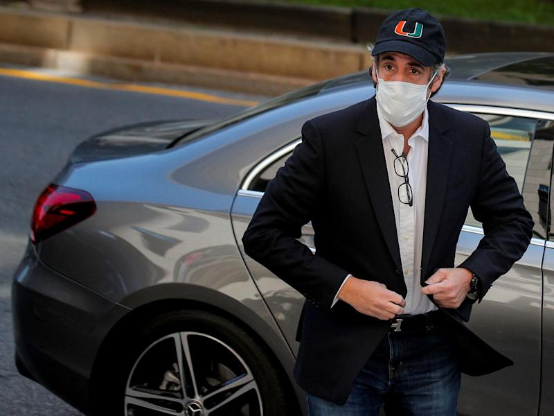 Michael Cohen arriving back at his home after being released early from prison: (Reuters)
