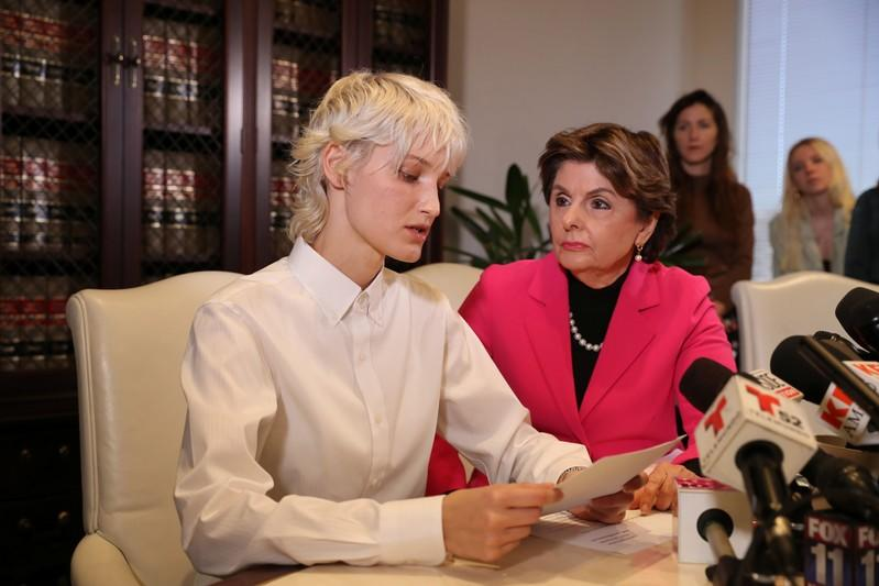 """""""Jane Doe 15,"""" a 31-year-old unidentified woman, who accuses the late financier Jeffrey Epstein of sexually abusing her when she was a child, speaks at a news conference in Los Angeles"""