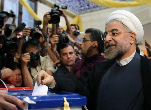 Hassan Rowhani casts his vote at a polling station in Tehran on June 14, 2013. Rowhani, bolstered by a late surge in support from suppressed Iranian reformists, took an early lead in the presidential election to find a successor to Mahmoud Ahmadinejad, initial results showed Saturday