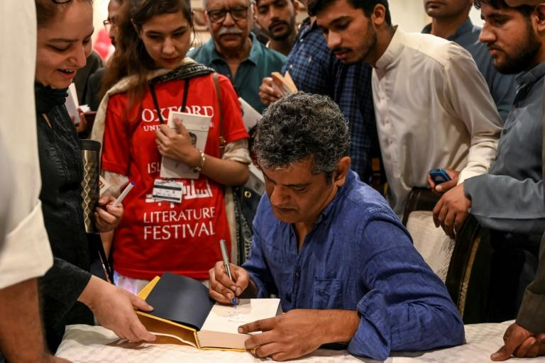 "Author Mohammed Hanif signing copies of his book ""A Case of Exploding Mangoes"" in Islamabad in September 2019 after the release of its Urdu translation Featuring bumbling generals, assassination plots, and homosexual romance, Pakistani military satire ""A Case of Exploding Mangoes"" by Mohammed Hanif has finally been released in the country's official language Urdu -- even as the army tightens its grip on freedom of expression"