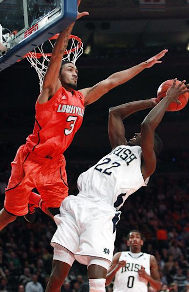 Louisville's Peyton Siva (3) defends Notre Dame's Jerian Grant (22) during the first half of an NCAA college basketball game in the semifinals of the Big East Conference tournament in New York, Friday, March 9, 2012. (AP Photo/Frank Franklin II)