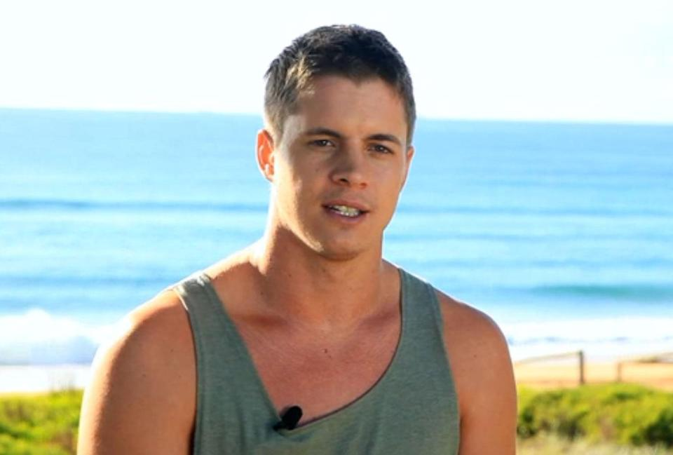 Johnny Ruffo in character as Chris Harrington on Home & Away in Sydney's Palm Beach