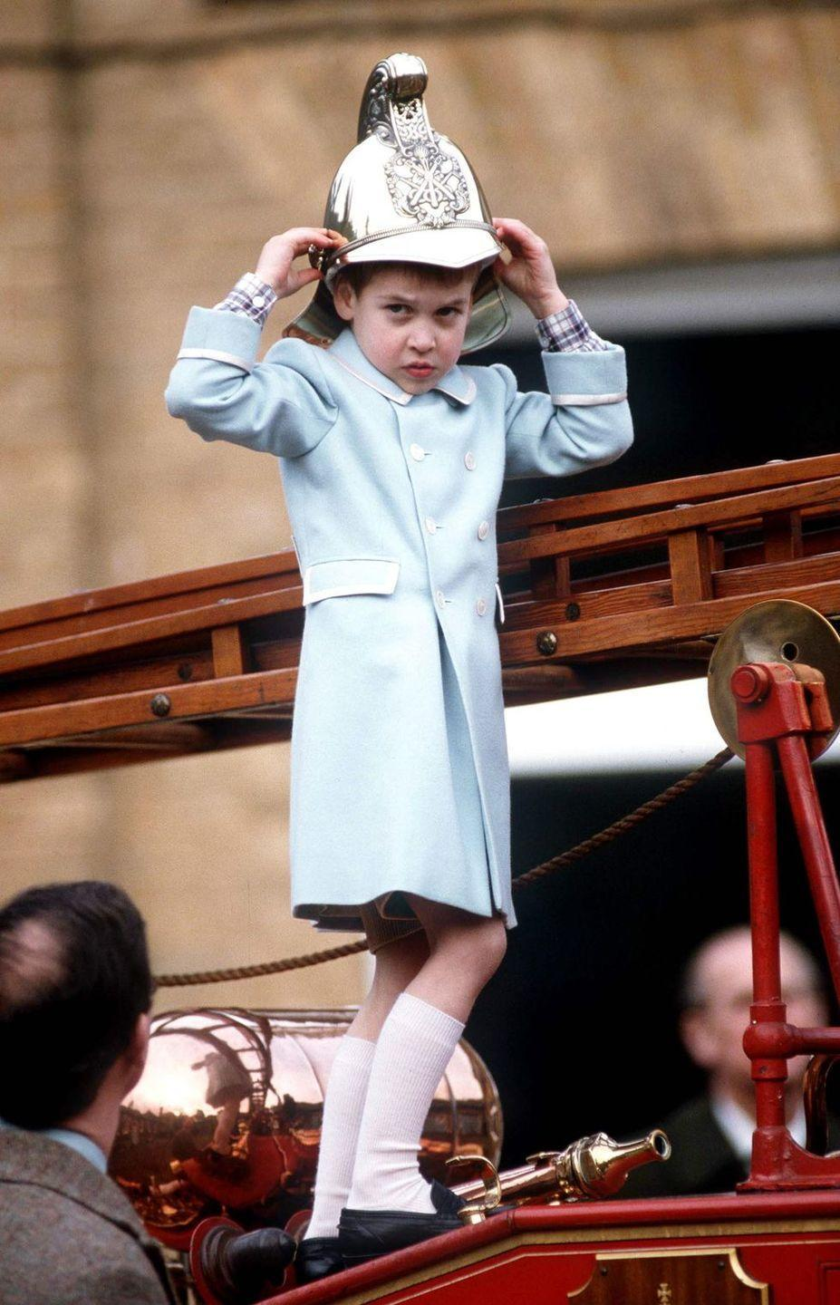 <p>Prince William tries on a fireman's helmet at the Sandringham Museum Of Royal Vehicles And Cars during the Christmas holidays.</p>