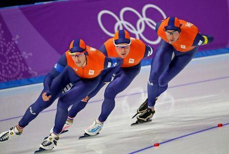 Feb 18, 2018; Pyeongchang, South Korea; Jan Blokhuijsen (NED), Sven Kramer (NED) and Koen Verweij (NED) in the mens speed skating team pursuit 8 laps quarterfinal during the Pyeongchang 2018 Olympic Winter Games at Gangneung Ice Arena. Mandatory Credit: Mark Hoffman-USA TODAY Sports
