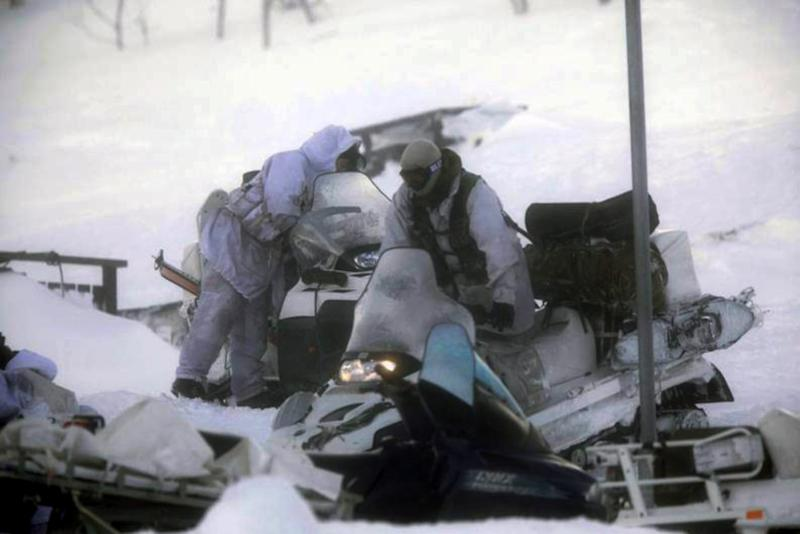 This Friday March 16, 2012 photo shows rescue personal in a search for the missing Norwegian C-130 Hercules cargo aircraft with five people onboard in the Kebnekaise mountain range in Northern Sweden. Rescuers have found the wreckage of a Norwegian military plane that crashed with five people on board during an exercise in northern Sweden, officials said Saturday.(AP Photo/Scanpix Sweden/Hans Olof Utsi) SWEDEN OUT