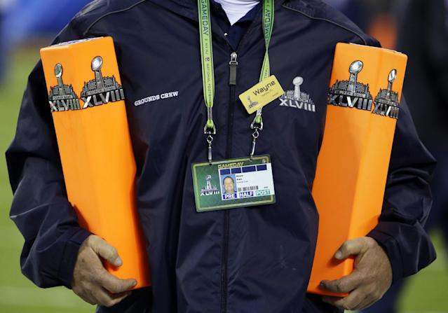 Grounds crew worker Wayne Ward sets up before the NFL Super Bowl XLVIII football game between the Seattle Seahawks and the Denver Broncos, Sunday, Feb. 2, 2014, in East Rutherford, N.J. (AP Photo/Matt Slocum)