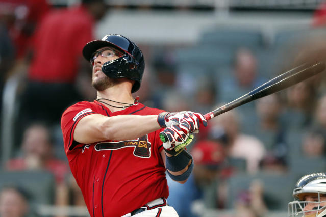 FILE - In this Aug. 30, 2019, file photo, Atlanta Braves' Tyler Flowers follows through on three-run home run in the second inning of a baseball game against the Chicago White Sox in Atlanta. The Braves have re-signed outfielder Nick Markakis and catcher Flowers to $4 million, one-year contracts for 2020 after declining their $6 million team options, which triggered $2 million buyout. (AP Photo/John Bazemore, File)