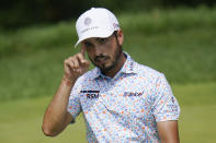 Abraham Ancer, of Mexico, reacts after putting on the the third tee during the third round of the BMW Championship golf tournament, Saturday, Aug. 28, 2021, at Caves Valley Golf Club in Owings Mills, Md. (AP Photo/Julio Cortez)