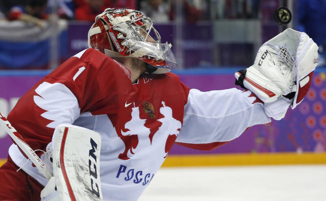 Russia goaltender Semyon Varlamov grabs a shot against Finland in the second period of a men's quarterfinal ice hockey game at the 2014 Winter Olympics, Wednesday, Feb. 19, 2014, in Sochi, Russia. (AP Photo/Julio Cortez)