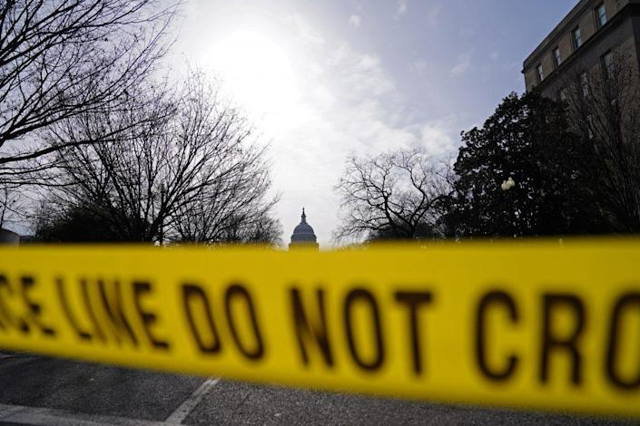 The U.S. Capitol is seen behind yellow police tape on January 16, 2021 in Washington, DC. After last week's riots at the U.S. Capitol Building, the FBI has warned of additional threats in the nation's capital and in all 50 states. According to reports, as many as 25,000 National Guard soldiers will be guarding the city as preparations are made for the inauguration of Joe Biden as the 46th U.S. President. (Photo by Eric Thayer/Getty Images)