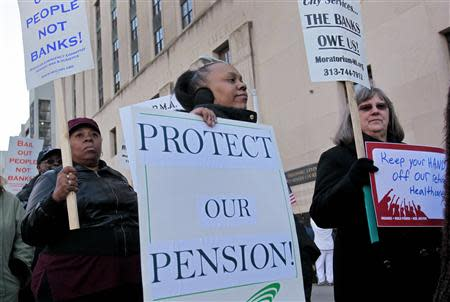Detroit city workers and retirees protest against the city's municipal bankruptcy filing, outside the Federal courthouse in Detroit