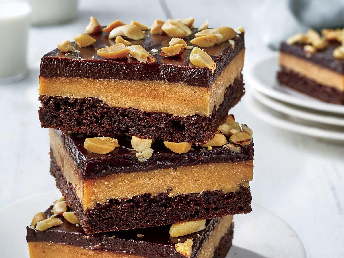 "<p>Your favorite candy can also be your favorite bar. These Chocolate Peanut Butter-Fudge Bars are perfect for bake sales, Valentine's Day, and a regular Tuesday night. Allow enough time for the top layer of melted chocolate to firm up before slicing <a href=""https://www.southernliving.com/food/holidays-occasions/best-cookies-recipes"">these triple-decker bars</a>. Leftovers can be covered and stored in the refrigerator up to three days, perfect for <a href=""https://www.southernliving.com/home-garden/holidays-occasions/how-to-entertain"">drop-in guests</a> or last-minute dinner parties.</p> <p><a href=""https://www.myrecipes.com/recipe/chocolate-peanut-butter-fudge-bars"">Chocolate Peanut Butter-Fudge Bars Recipe</a></p>"