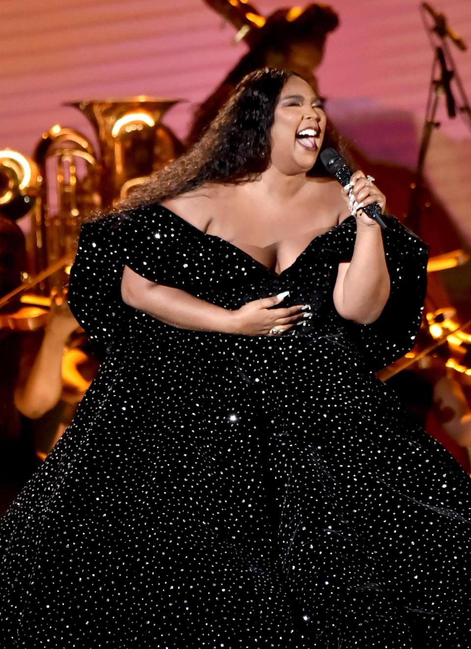 """The singer took to the Grammys stage to sing """"Cuz I Love You"""" in a custom off-the-shoulder gown by Christian Siriano."""
