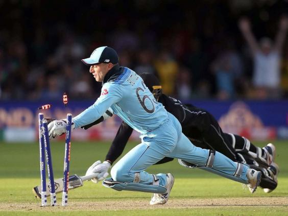 Jos Buttler breaking the bails to clinch England's World Cup win (PA)
