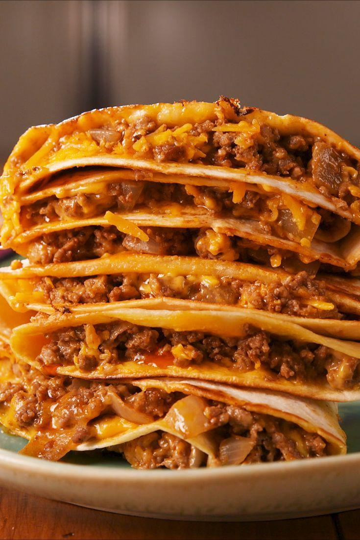 """<p>Stack 'em as high as you'd like! Onion, beef, cheese, and tortillas are always an A+ combination. </p><p>Get the recipe from <a href=""""https://www.delish.com/cooking/recipe-ideas/a23721780/copycat-taco-bell-stackers-recipe/"""" rel=""""nofollow noopener"""" target=""""_blank"""" data-ylk=""""slk:Delish"""" class=""""link rapid-noclick-resp"""">Delish</a>. </p>"""