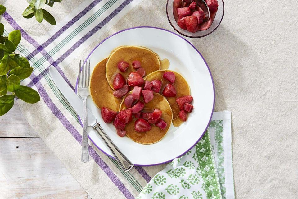 """<p>A cup of ricotta cheese magically makes these pancakes both lighter <em>and</em> richer. But it's the <a href=""""https://www.countryliving.com/food-drinks/a35683930/roasted-maple-rhubarb-and-strawberries-recipe/"""" rel=""""nofollow noopener"""" target=""""_blank"""" data-ylk=""""slk:roasted maple Rhubarb and strawberries"""" class=""""link rapid-noclick-resp"""">roasted maple Rhubarb and strawberries</a> that really makes them Mother's-Day-worthy.</p><p><strong><a href=""""https://www.countryliving.com/food-drinks/a35683213/ricotta-pancakes/"""" rel=""""nofollow noopener"""" target=""""_blank"""" data-ylk=""""slk:Get the recipe"""" class=""""link rapid-noclick-resp"""">Get the recipe</a>.</strong></p><p><a class=""""link rapid-noclick-resp"""" href=""""https://www.amazon.com/Home-table-folding-breakfast-Bamboo/dp/B00PHS97EU/?tag=syn-yahoo-20&ascsubtag=%5Bartid%7C10050.g.1681%5Bsrc%7Cyahoo-us"""" rel=""""nofollow noopener"""" target=""""_blank"""" data-ylk=""""slk:SHOP BREAKFAST TRAYS"""">SHOP BREAKFAST TRAYS</a></p>"""