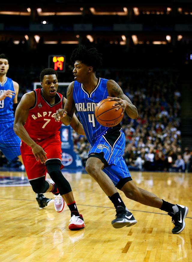 LONDON, ENGLAND - JANUARY 14: Elfrid Payton #4 of the Orlando Magic dribbles past Kyle Lowry #7 of the Toronto Raptors during the 2016 NBA Global Games London match between Toronto Raptors and Orlando Magic at The O2 Arena on January 14, 2016 in London, England. (Photo by Clive Rose/Getty Images)