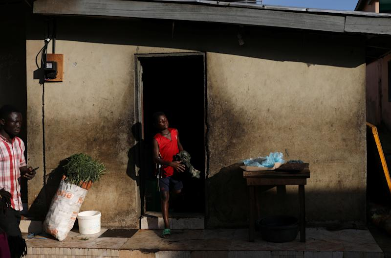 A boy walks out of his home in Mampong, a small town in the Ashanti region, Ghana. (Photo: Siphiwe Sibeko/Reuters)