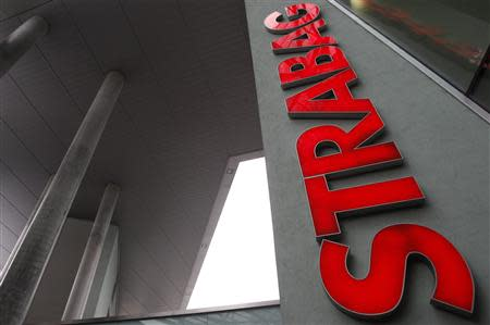 The logo of Austrian builder Strabag is pictured on its headquarters in Vienna in this January 27, 2011 file photo. REUTERS/Lisi Niesner/Files