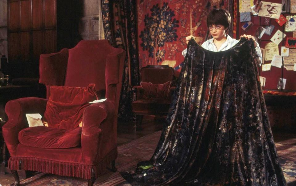 Harry Potter receives an invisibility cloak