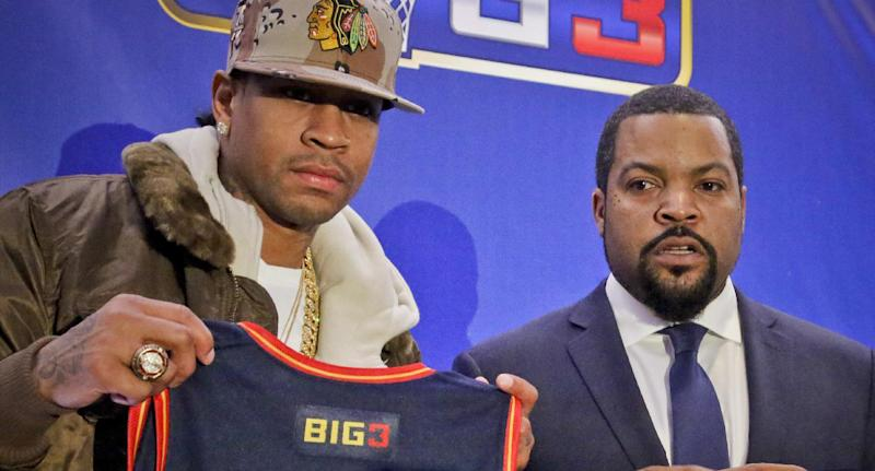 Former NBA player Allen Iverson, left, shows his jersey as he poses with entertainer Ice Cube after they announced the launch of the BIG3, a new 3-on-3 professional basketball league, in New York, Wednesday, Jan. 11, 2017. (AP Photo/Bebeto Matthews)