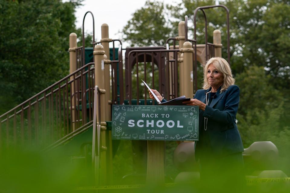 Jill Biden, wife of Democratic presidential candidate former Vice President Joe Biden, walks from a podium in front of a closed playground during a tour of the Evan G. Shortlidge Academy in Wilmington, Del., Tuesday, Sept. 1, 2020, to launch a multi-week swing through 10 battleground states.