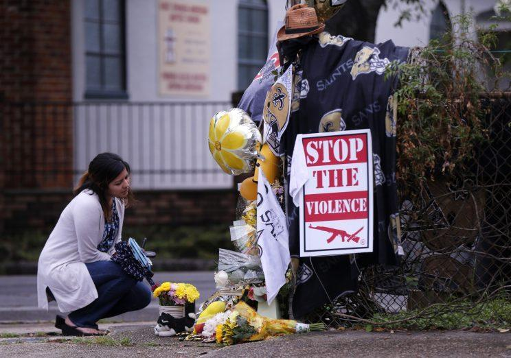 A makeshift memorial was erected near the spot where former New Orleans Saints defensive end Will Smith was shot and killed. (AP)
