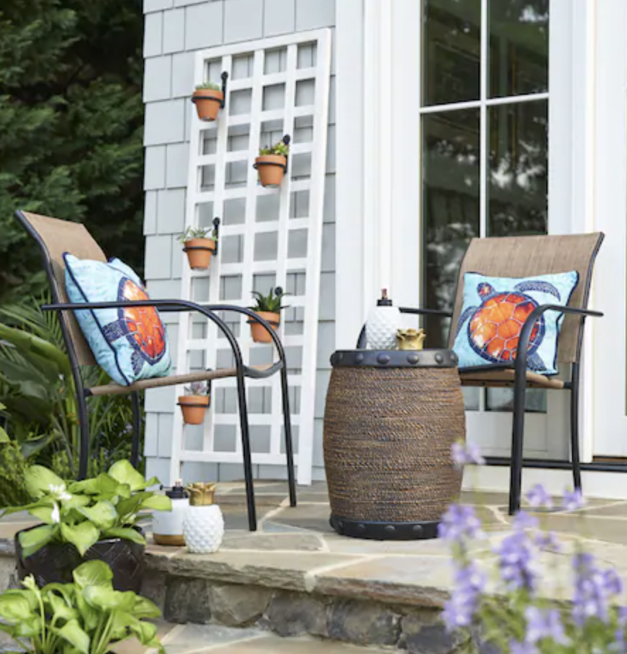 """<p><strong>Garden Treasures</strong></p><p>lowes.com</p><p><strong>$19.98</strong></p><p><a href=""""https://go.redirectingat.com?id=74968X1596630&url=https%3A%2F%2Fwww.lowes.com%2Fpd%2Fgarden-treasures-pelham-bay-stackable-metal-stationary-dining-chair-s-with-tan-sling-seat%2F1000707134&sref=https%3A%2F%2Fwww.goodhousekeeping.com%2Fhome-products%2Fg32743125%2Fbest-patio-chairs%2F"""" rel=""""nofollow noopener"""" target=""""_blank"""" data-ylk=""""slk:Shop Now"""" class=""""link rapid-noclick-resp"""">Shop Now</a></p><p>Not only is this stackable chair's tan color brilliant for masking stains, its fabric dries quickly to make cleaning a breeze. </p>"""