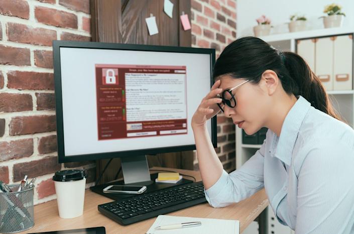 """<span class=""""caption"""">Ransomware attacks often strike local government computer systems, which poses a challenge for protecting elections.</span> <span class=""""attribution""""><a class=""""link rapid-noclick-resp"""" href=""""https://www.gettyimages.com/detail/photo/woman-finding-computer-getting-virus-attack-royalty-free-image/847207652"""" rel=""""nofollow noopener"""" target=""""_blank"""" data-ylk=""""slk:PRImageFactory/iStock via Getty Images"""">PRImageFactory/iStock via Getty Images</a></span>"""